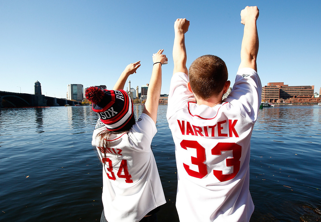 . BOSTON, MA - NOVEMBER 02: Fans cheer from the shore of the Charles Rivers during the World Series victory parade on November 2, 2013 in Boston, Massachusetts.  (Photo by Jared Wickerham/Getty Images)