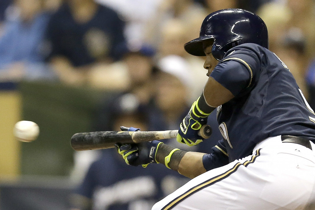 . MILWAUKEE, WI - JUNE 27: Jean Segura #9 of the Milwaukee Brewers lays down a sacrifice bunt in the bottom of the seventh inning to move runners in scoring position against the Colorado Rockies at Miller Park on June 27, 2014 in Milwaukee, Wisconsin. (Photo by Mike McGinnis/Getty Images)