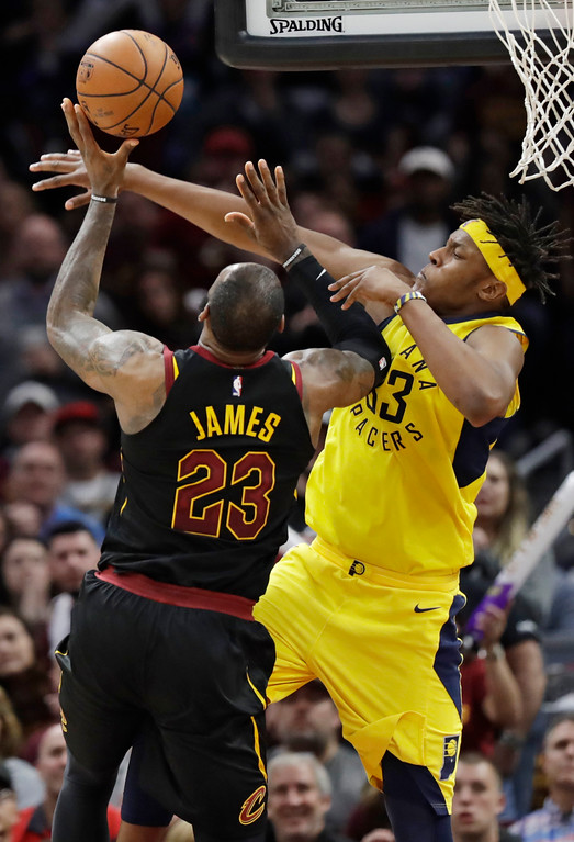 . Indiana Pacers\' Myles Turner (33) blocks a shot by Cleveland Cavaliers\' LeBron James (23) in the second half of Game 5 of an NBA basketball first-round playoff series, Wednesday, April 25, 2018, in Cleveland. (AP Photo/Tony Dejak)