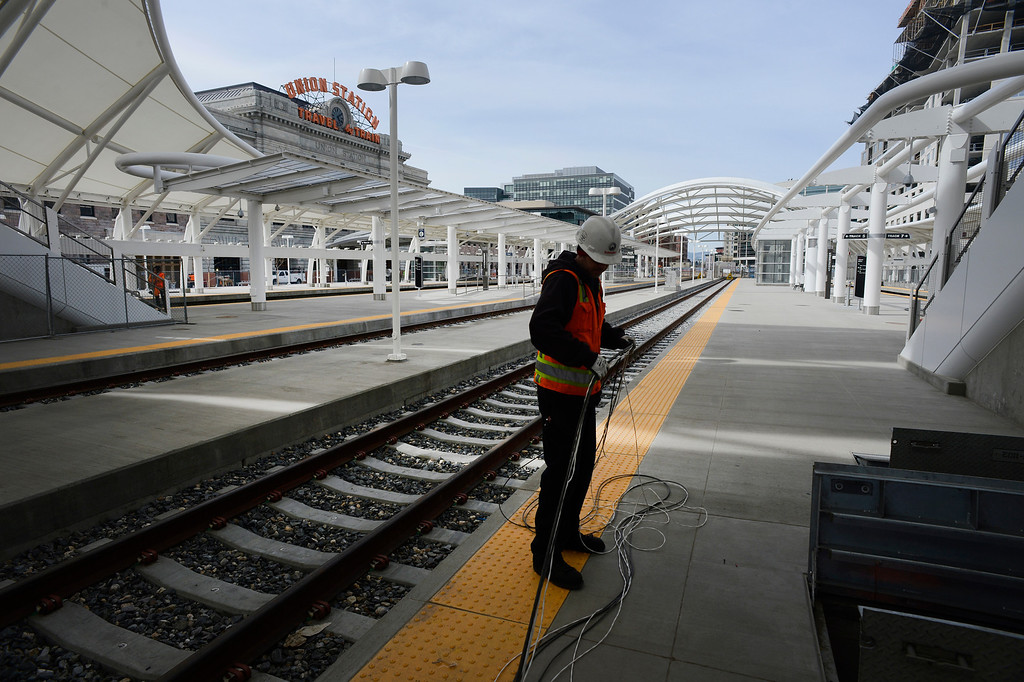 . DENVER, CO. - APRIL 25: A worker runs cable underground near rail tracks at the RTD Union Station Transit Center Train Hall area Friday morning, April 25, 2014. (Photo By Andy Cross / The Denver Post)