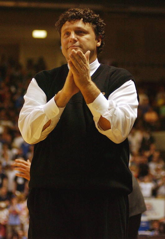 . Oakland University men\'s basketball head coach Greg Kampe cheers on his team as they played Oral Roberts for the Mid-Continent Conference Championship, Tuesday, March 8, 2005, at the John Q. Hammons Arena in Tulsa, OK.  Oakland defeated Oral Roberts, 61-60, and won a spot in the NCAA tournament.