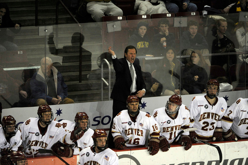 . Denver Pioneers Head Coach George Gwozdecky yells at the ref after a call during the third period against Colorado College Tigers February 5, 2011 at Magness Arena.  DU defeated CC 5-3.  John Leyba, The Denver Post