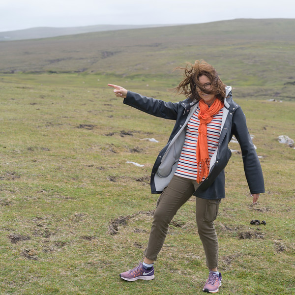 Woman standing on a field, Erris Head Loop Walk, Belmullet, County Mayo, Ireland
