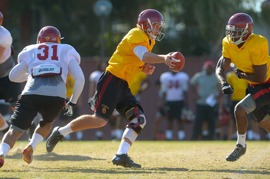 . Quarterback Max Wittek runs a play during a USC practice August 20, 2013.(Andy Holzman/Los Angeles Daily News)