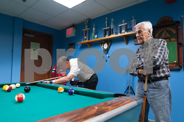 12/05/17 Wesley Bunnell | Staff Guimont Carrier, L, shoots as opponent Gaston Toussaint looks on during a game of 8 ball at the Bristol Senior Center on Tuesday afternoon.