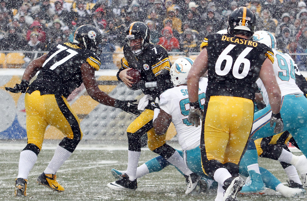 . Ben Roethlisberger #7 of the Pittsburgh Steelers is sacked by Paul Soliai #96 of the Miami Dolphins during the game on December 8, 2013 at Heinz Field in Pittsburgh, Pennsylvania. (Photo by Justin K. Aller/Getty Images)