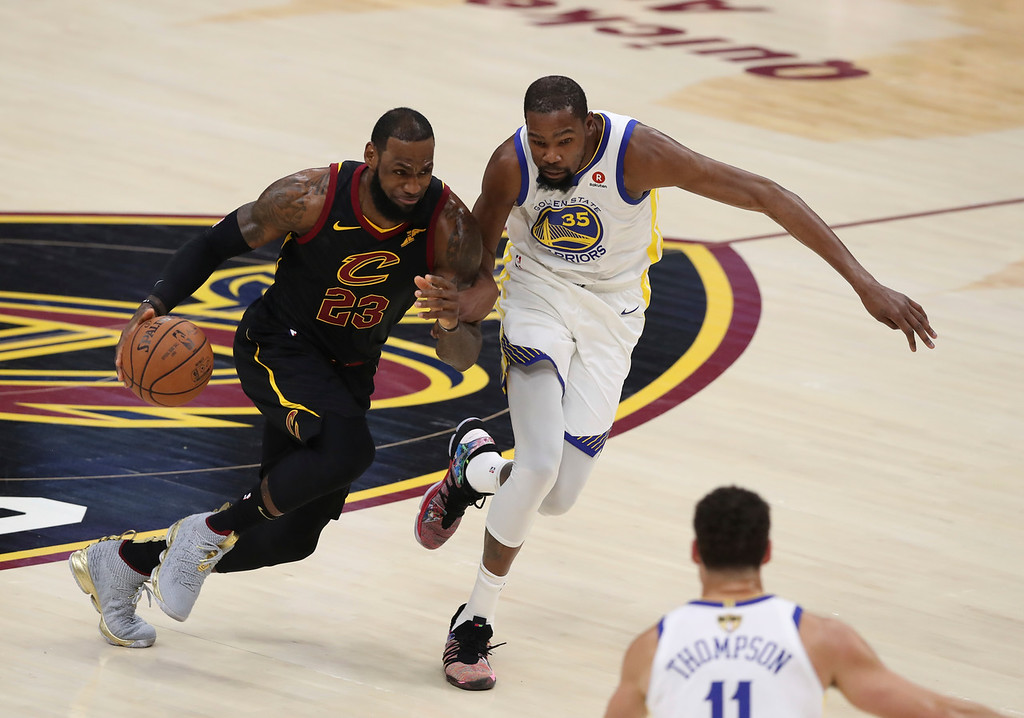 . Cleveland Cavaliers\' LeBron James goes to the basket against Golden State Warriors\' Kevin Durant in the first half of Game 3 of basketball\'s NBA Finals, Wednesday, June 6, 2018, in Cleveland. (AP Photo/Carlos Osorio)