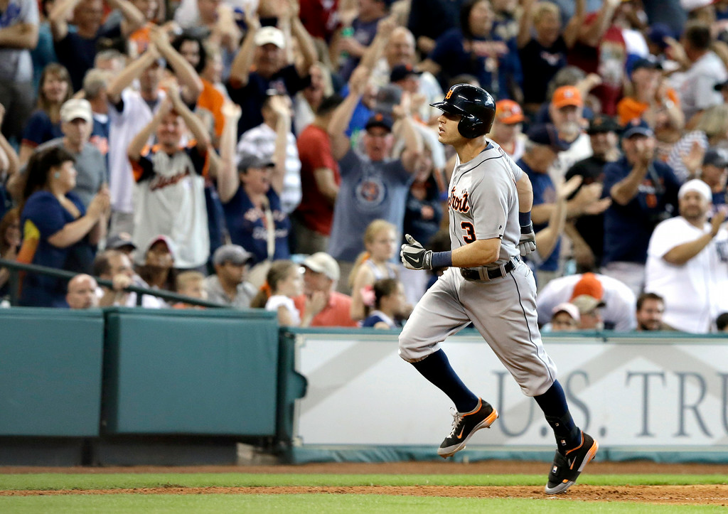 . Fans cheer as Detroit Tigers\' Ian Kinsler runs down the third base line on a three-run homer against the Houston Astros in the ninth inning of a baseball game Saturday, June 28, 2014, in Houston. The Tigers won 4-3. (AP Photo/Pat Sullivan)