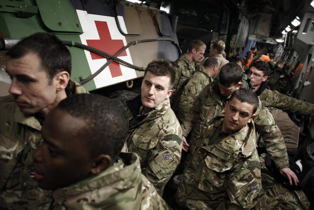 Description of . English soldiers are seen inside a British army Boeing C-17 cargo aircraft arriving from the British Brize Norton base and en route to Bamako, on January 13, 2013 at the Evreux military Base. Britain supports France's decision to send troops to support an offensive by Mali government forces against Islamist rebels.  CHARLY TRIBALLEAU/AFP/Getty Images