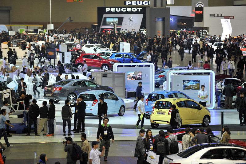 . Visitors stroll the alleys of the Seoul Motor Show during a press preview in Goyang, north of Seoul, on March 28, 2013.  South Korea\'s largest international auto show will open on March 29, with all Korean car manufacturers showing their latest cars and concepts amongst the 384 companies from 14 countries taking part in the event.  JUNG YEON-JE/AFP/Getty Images