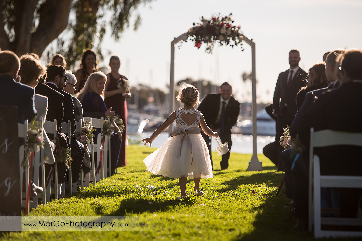 flower girl going down the aisle during wedding ceremony at San Diego Marina Village