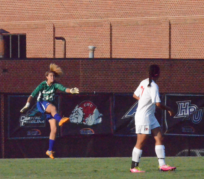 Amy Schmitt (99) makes a powerful kick to send the ball down to her teamates.