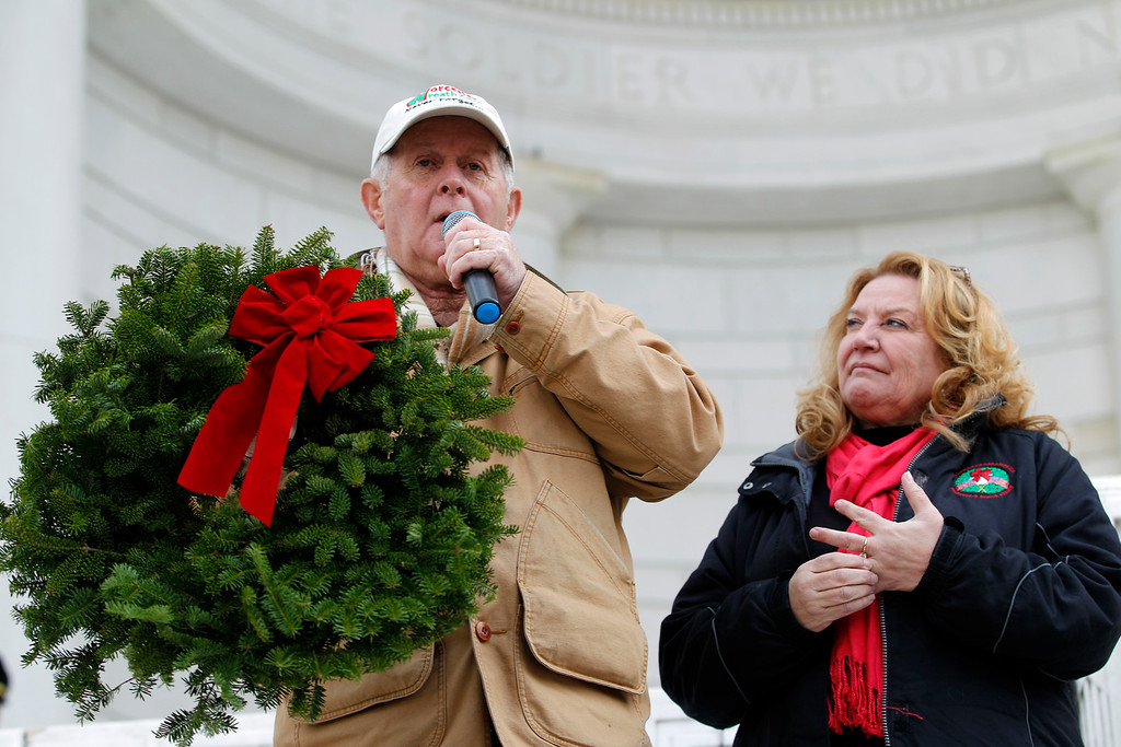 . Maine businessman Morrill Worcester and his wife Karen speak in the opening ceremony of laying holiday wreaths at graves at Arlington National Cemetery in Arlington, Va., Saturday Dec. 15, 2012, during Wreaths Across America Day. Wreaths Across America was started in 1992 at Arlington National Cemetery by Maine businessman Morrill Worcester and has expanded to hundreds of veterans\' cemeteries and other locations in all 50 states and beyond. (AP Photo/Jose Luis Magana)
