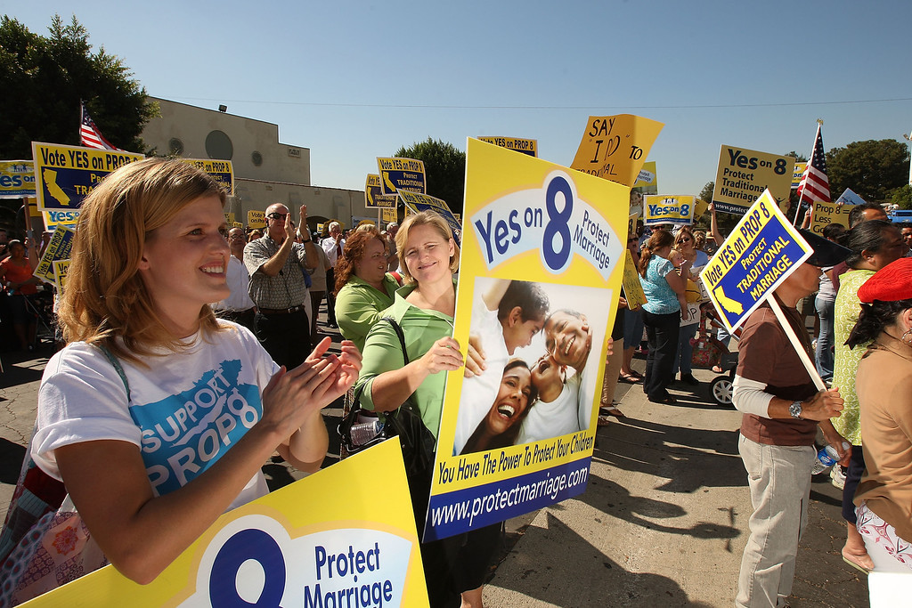 . LOS ANGELES, CA - OCTOBER 24:  Supporters of Proposition 8, which would outlaw same-sex marriage throughout California, rally during a \'Yes on 8 bus tour\' stop at St. Frances X Cabrini Church on October 24, 2008 in Los Angeles, California. As same-sex marriages became legal in California on June 16, conservative churches vowed to fight it and are spearheading passage of Proposition 8 which would change the state constitution to recognize only marriages between one man and one woman as legal. Funding for the campaign to pass Prop 8 has dwarfed that of their opponents in large part because of the resources of conservative churches which maintain that homosexuality is sinful.  (Photo by David McNew/Getty Images)