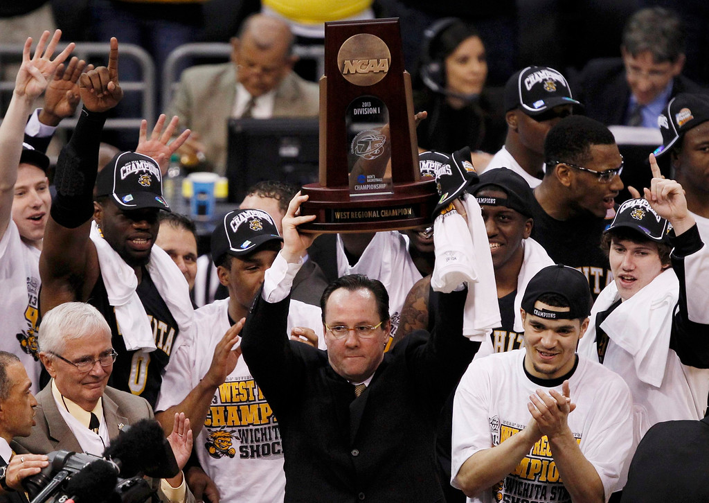 . Wichita State Shockers head coach Gregg Marshall holds up the West Region Trophy after defeating the Ohio State Buckeyes following their West Regional NCAA men\'s basketball game in Los Angeles, California March 30, 2013.  REUTERS/Alex Gallardo