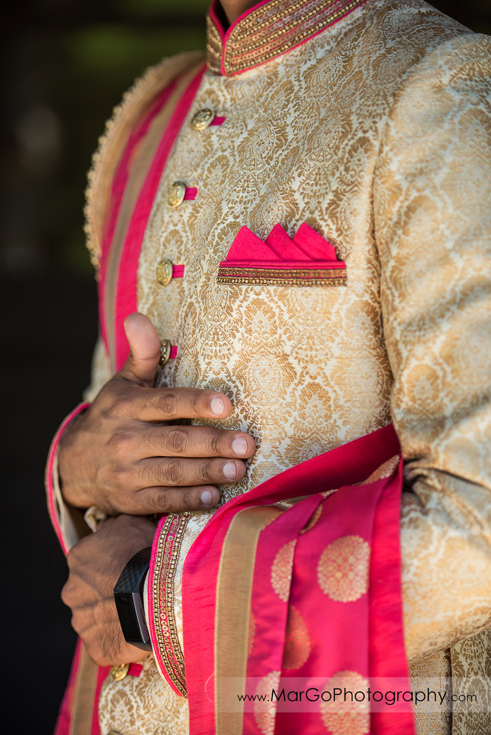 pink and golden Indian groom sherwani details
