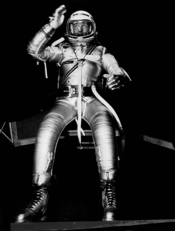 . Astronaut M. Scott Carpenter, one of seven men being trained for space flight, moves his arms to test the mobility of a full pressure suit being developed for use by the Project Mercury trainees. The suit is a prototype designed to protect the astronauts from heat and pressure conditions expected to be encountered during flight. The tests are being conducted at the Navy Air Material Center, Philadelphia, Pennsylvania, Nov. 23, 1959. (AP Photo)