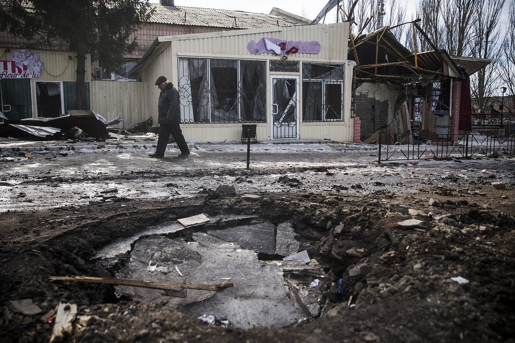 . DEBALTSEVE, UKRAINE - FEBRUARY 25:  A man walks past a destroyed building on February 25, 2015 in Debaltseve, Ukraine. After approximately one month of fighting, Russian backed rebels successfully forced Ukrainian troops to withdraw from the town of 100,00 people on February 18. Only approximately 11,000 civilians remain in the town. Debaltseve is considered an asset to both Ukrainians and the rebels due to the railway station and it\'s connection to other eastern Ukranian towns.  (Photo by Andrew Burton/Getty Images)