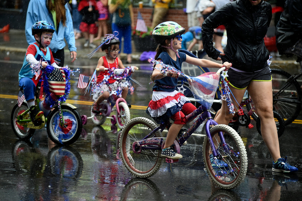 . Kayla Rice/Reformer Children ride their bikes, decorated for the holiday, in the Brattleboro Fourth of July parade on Friday.