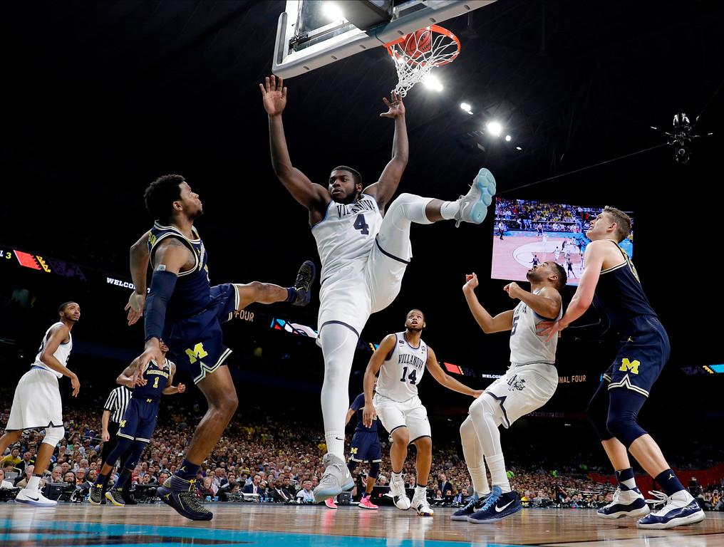 . Villanova\'s Eric Paschall (4) shoots over Michigan\'s Zavier Simpson during the second half in the championship game of the Final Four NCAA college basketball tournament, Monday, April 2, 2018, in San Antonio. (AP Photo/Eric Gay)