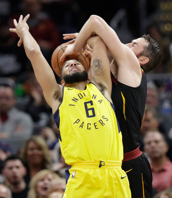 . Indiana Pacers\' Cory Joseph (6) and Cleveland Cavaliers\' Kevin Love, right, battle for the ball in the first half of Game 1 of an NBA basketball first-round playoff series Sunday, April 15, 2018, in Cleveland. (AP Photo/Tony Dejak)