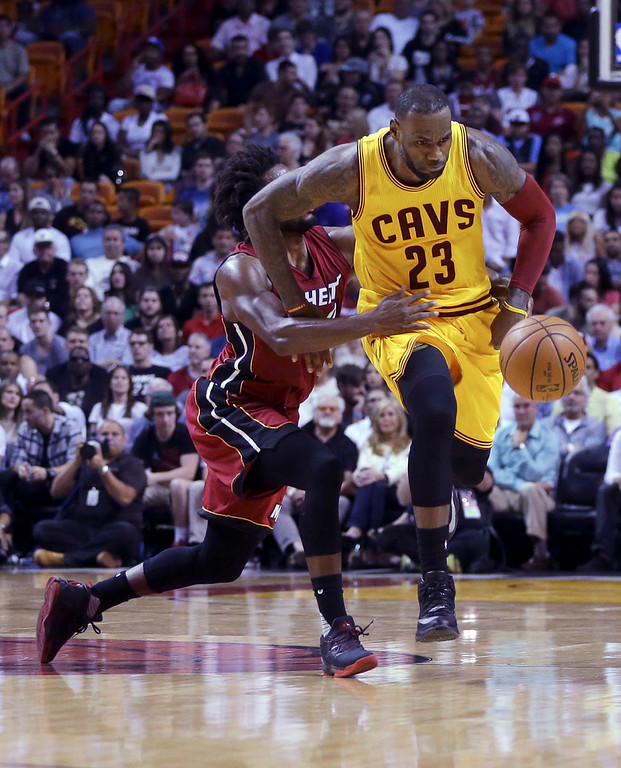. Cleveland Cavaliers forward LeBron James (23) is fouled by Miami Heat forward Justise Winslow, left, during the first half of an NBA basketball game, Saturday, March 19, 2016, in Miami. (AP Photo/Lynne Sladky)