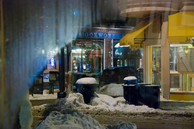 Night, on State Street, Madison, Wisconsin. Looking out the window of the Fair Trade Coffee House.