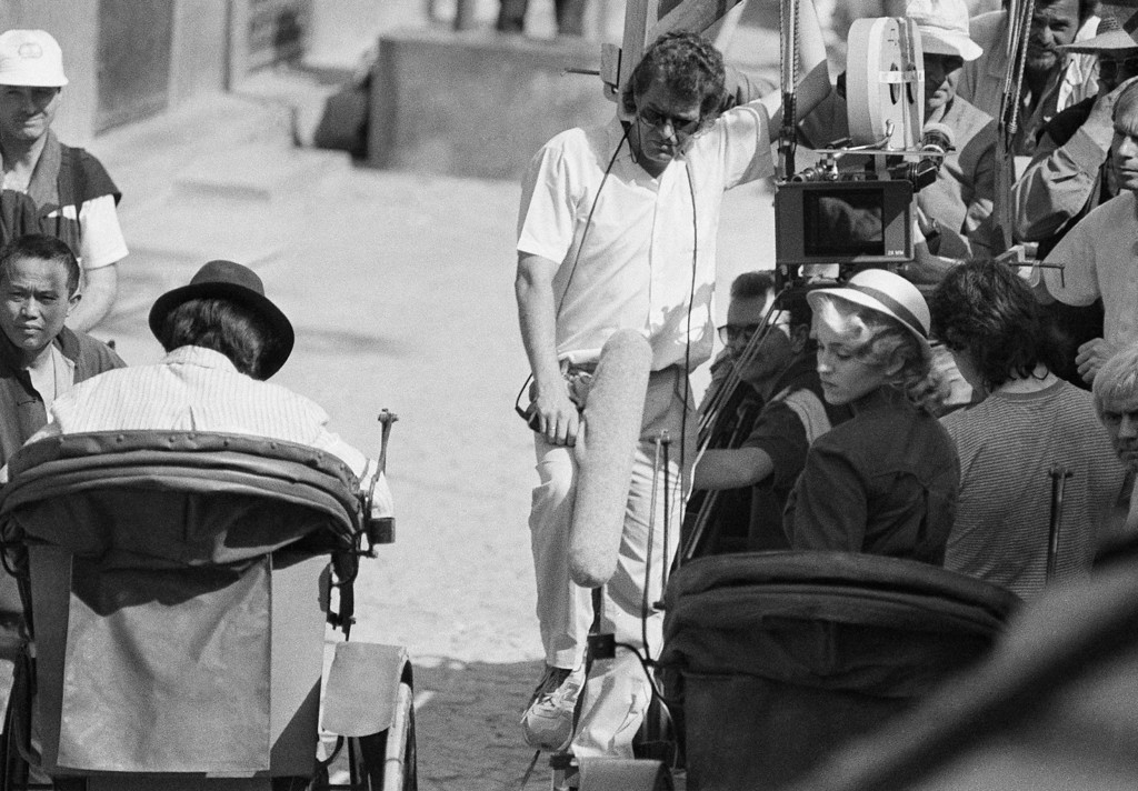""". American pop superstar Madonna looks over her shoulder from a rickshaw during the shooting of the film \""""Shanghai Surprise\"""" in the Portuguese colony of Macao, Jan. 20, 1986. Madonna stars opposite her husband Sean Penn in the movie. (AP Photo/Dick Fung)"""