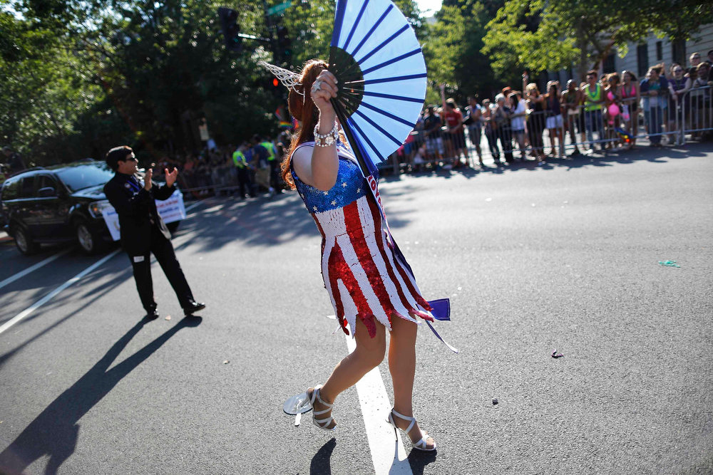 . A drag queen dressed in red, white and blue takes part in the gay-pride themed Capital Pride Parade in Washington, June 8, 2013. REUTERS/Jonathan Ernst