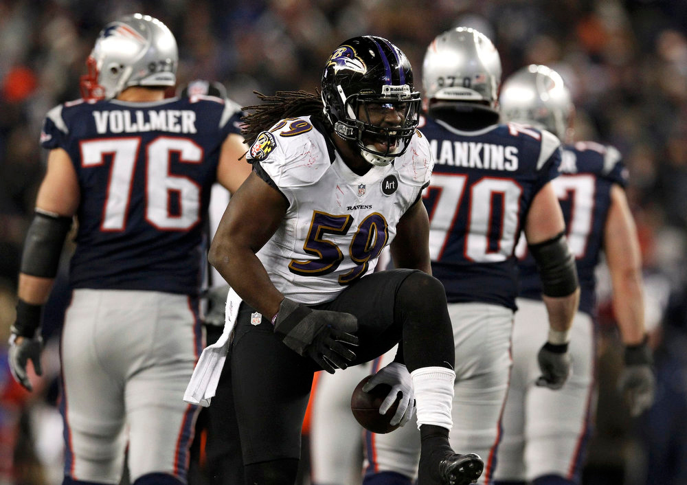 . Baltimore Ravens inside linebacker Dannell Ellerbe (59) celebrates his fourth quarter interception against the New England Patriots in the NFL AFC Championship football game in Foxborough, Massachusetts, January 20, 2013. REUTERS/Jim Young