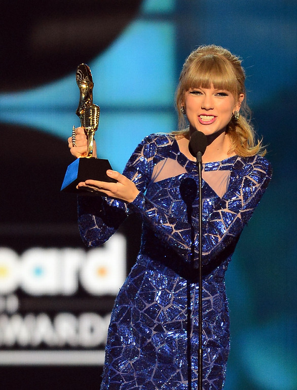 ". Singer Taylor Swift accepts the award for ""Top Billboard 200 Album\"" onstage during the 2013 Billboard Music Awards at the MGM Grand Garden Arena on May 19, 2013 in Las Vegas, Nevada.  (Photo by Ethan Miller/Getty Images)"