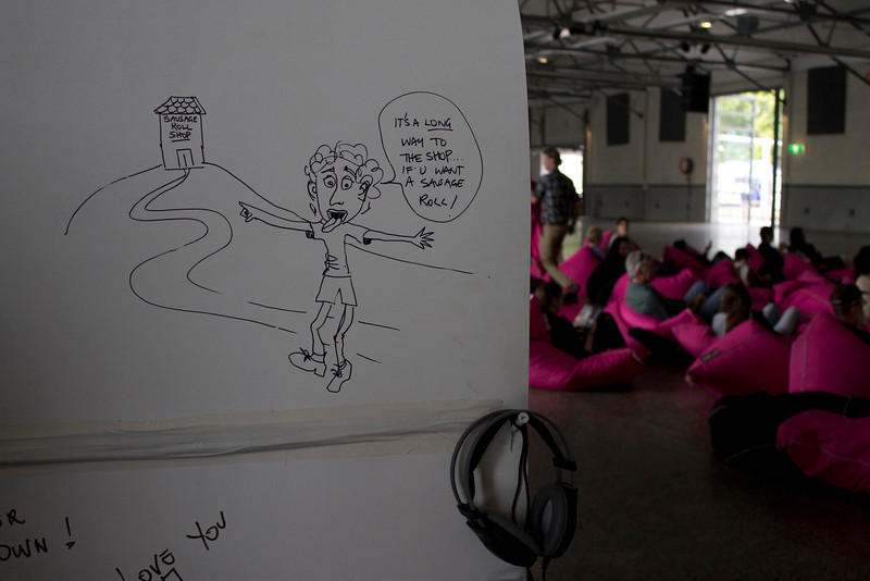 """This was graffiti on the installation surrounding Nell's cover of AC/DC's """"It's a Long Way to the Top (If You Wanna Rock N Roll)"""". I love the playful, light-hearted, and non-vulgar nature of the graffiti, as well as the way it is accented by the headphones (hinting at music) and the pink beanbags (for a splash of color)."""