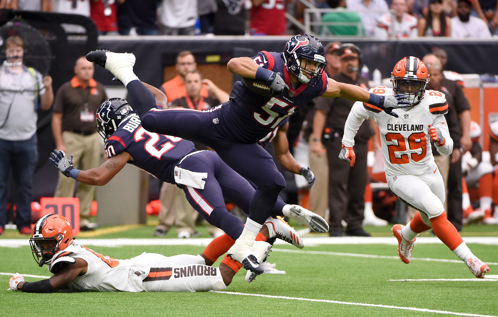 . Houston Texans linebacker Dylan Cole (51) is upended by Cleveland Browns wide receiver Rashard Higgins, left, as running back Duke Johnson Jr. (29) watches after Cole intercepted a pass in the first half of an NFL football game, Sunday, Oct. 15, 2017, in Houston. (AP Photo/Eric Christian Smith)