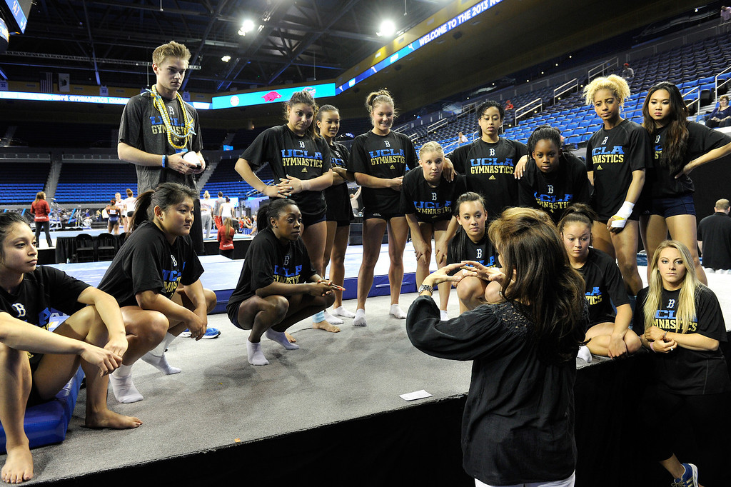 . Head coach Valerie Kondos Field talks to the UCLA women\'s gymnastics team before their practice, Thursday, April 18, 2013, for the upcoming NCAA Women\'s Gymnastics Championships at Pauley Pavilion. (Michael Owen Baker/Staff Photographer)