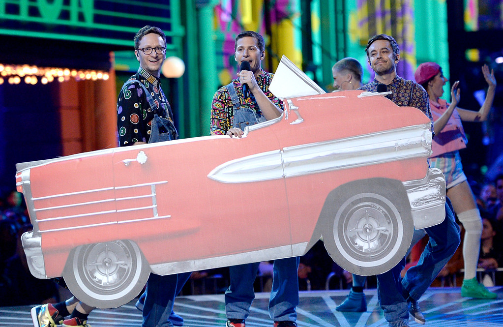 . Akiva Schaffer, from left, Andy Samberg and Jorma Taccone, of Lonely Island, perform a tribute to generation award winner Will Smith at the MTV Movie Awards at Warner Bros. Studio on Saturday, April 9, 2016, in Burbank, Calif. (Kevork Djansezian/Pool Photo via AP)