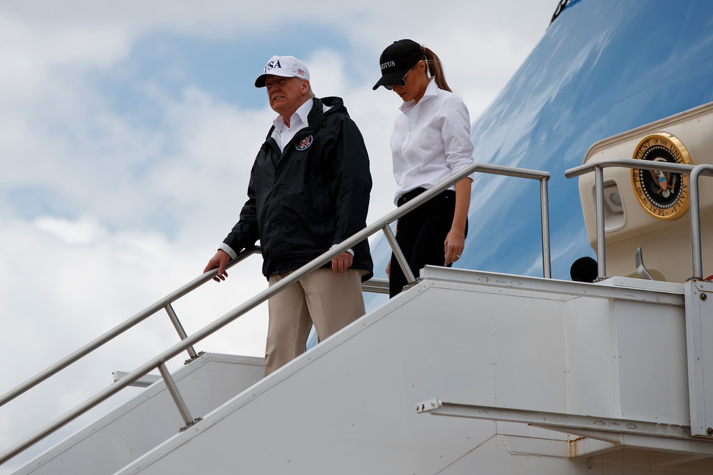 . President Donald Trump and first lady Melania Trump arrive on Air Force One at Austin-Bergstrom International Airport in Austin, Texas, Tuesday, Aug. 29, 2017, wldfor briefings on Harvey relief efforts. (AP Photo/Evan Vucci)