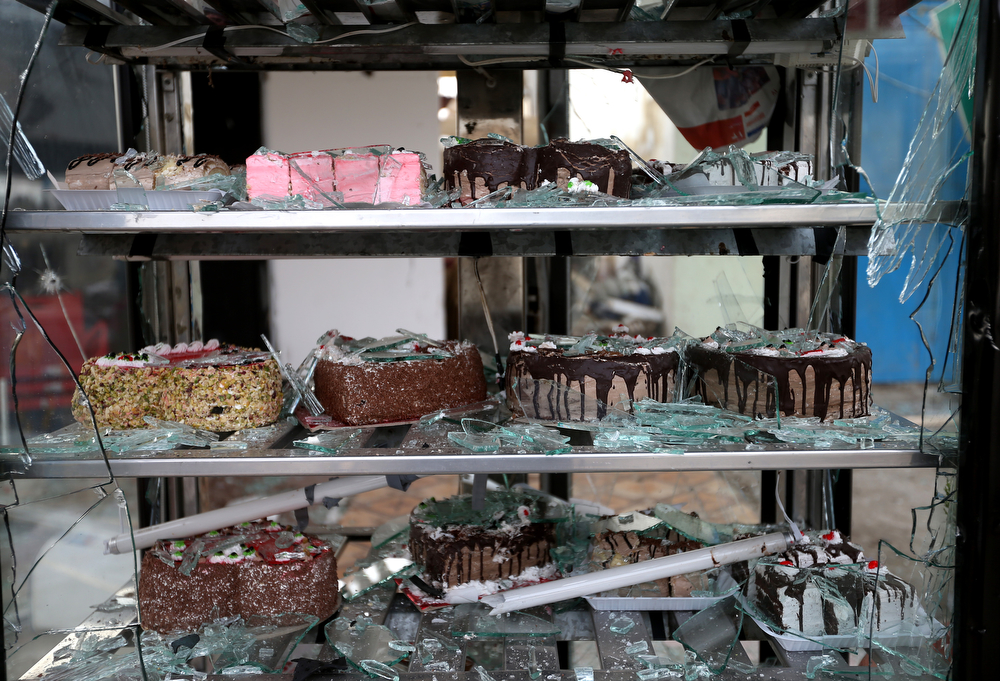 . Cakes are seen inside a broken refrigerator in a patisserie shop, damaged by a deadly car bomb that exploded Saturday evening near a gas station, in the predominately Shiite town of Hermel, about 10 miles (16 kilometers) from the Syrian border in northeast Lebanon, Sunday, Feb. 2, 2014. (AP Photo/Hussein Malla)