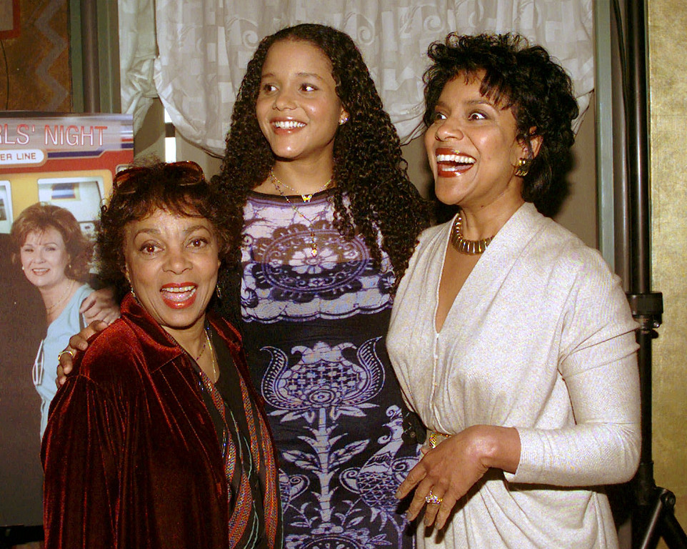 . Actors Ruby Dee, left, Sydney Tamiia Poitier, center, and Phylicia Rashad, all had roles Showtime programming, pose for a photograph at the Rainbow Room in New York on Friday, Feb. 20, 1998. (AP Photo/Adam Nadel)