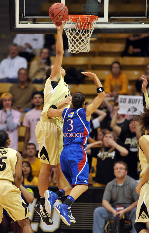 . BOULDER, CO. - MARCH 23: Jamee Swan of Colorado Buffaloes (50), top left, blocks the shot of Angel Goodrich of Kansas Jayhawks (3) during the first round of the 2013 NCAA women\'s Basketball Tournament at Coors Events Center. Boulder, Colorado. March 23, 2013. Kansas won 67-52. (Photo By Hyoung Chang/The Denver Post)