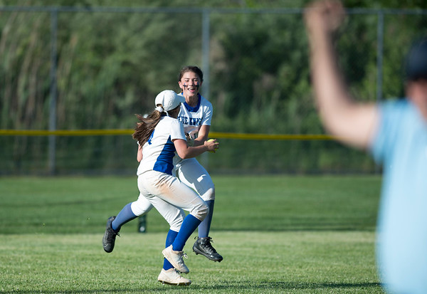 06/03/19 Wesley Bunnell | Staff Southington softball defeated Trumbull in a semifinal Class LL game at DeLuca Field in Stratford on Monday afternoon. Nicole Greco (4) and Kelsey Fernandez (1) after Greco caught a fly ball for the last out of the game.