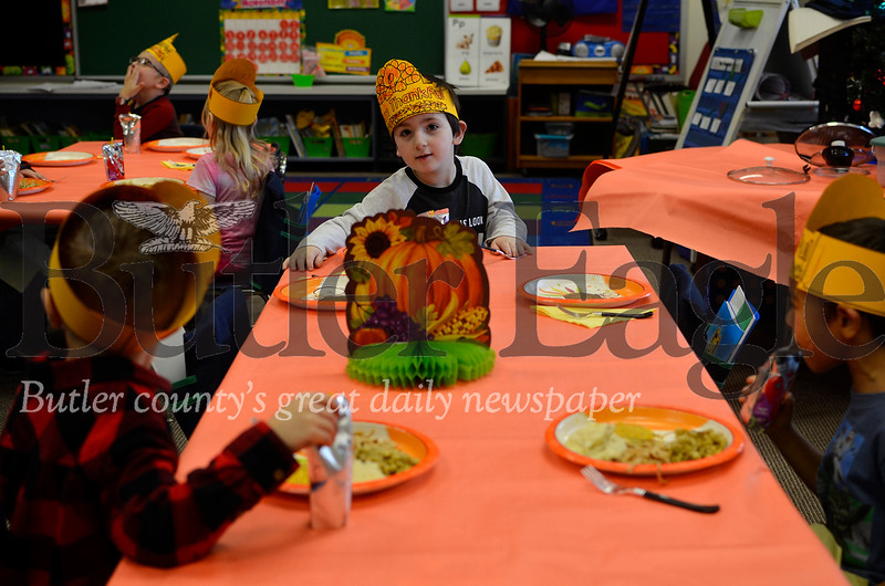 Brandon Campbell and his classmates in Lindsay Rahl's kindergarten class dine on a Thanksgiving feast in class on Tuesday. The Emily Brittain Elementary students said they enjoyed the food. Tanner Cole/Butler Eagle