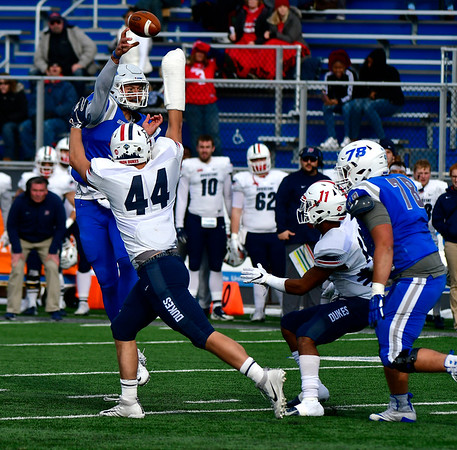 11/17/2018 Mike Orazzi | Staff CCSU's Jacob Dolegala (9) and Duquesne's Chris Favoroso (44) at Arute Field in New Britain Saturday afternoon.