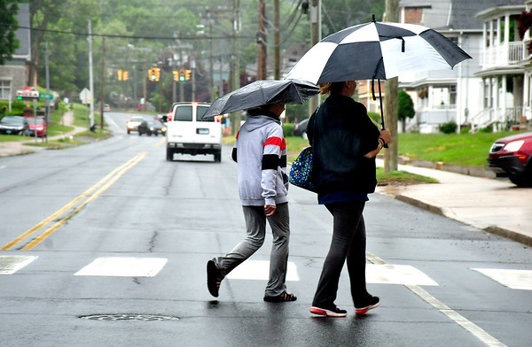 5/28/2019 Mike Orazzi | Staff Pedestrians cross West Street during Tuesday's rain in Bristol.