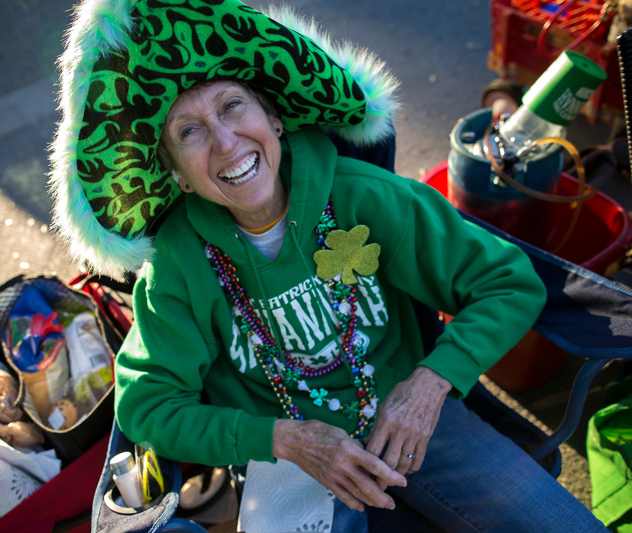 . Dressed for the 65th St. Patrick\'s Day parade, Faye Kirschner waits for the start of the parade,Tuesday, March 17, 2015, in Savannah, Ga. Savannah has been celebrating St. Patrick\'s Day for 191 years.  (AP Photo/Stephen B. Morton)