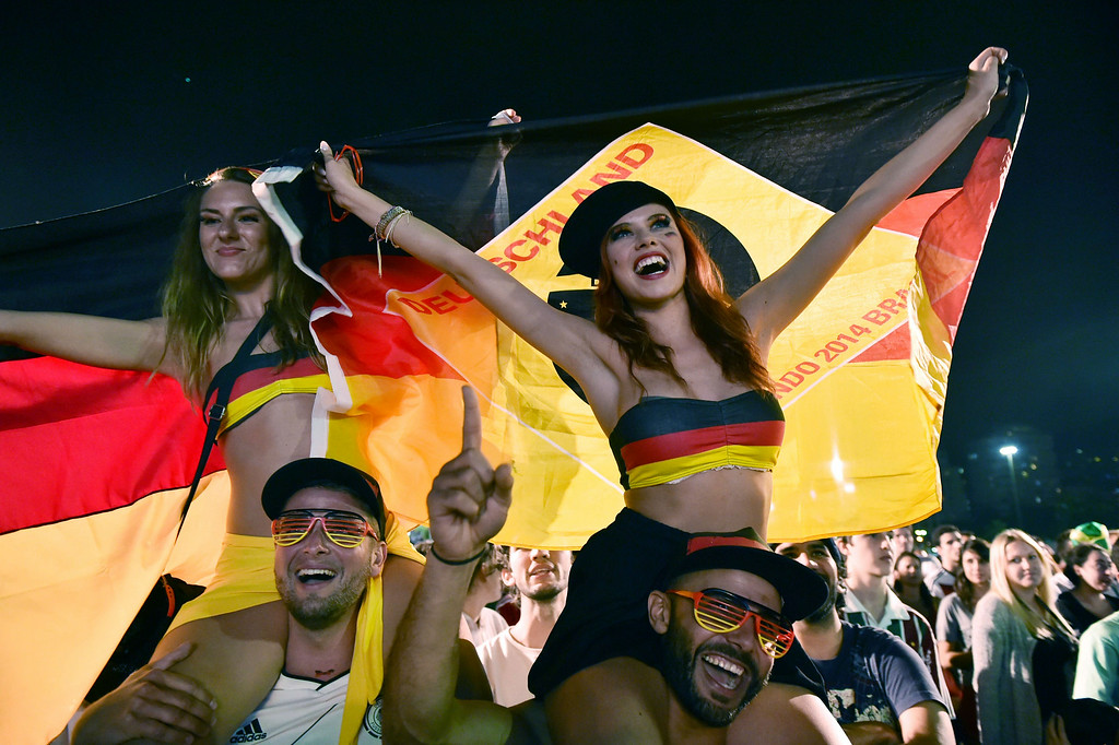 . Germany\'s supporters react as they watch a Round of 16 football match between Germany and Algeria on a giant screen in Rio de Janeiro, during the 2014 FIFA World Cup on June 30, 2014.     YASUYOSHI CHIBA/AFP/Getty Images