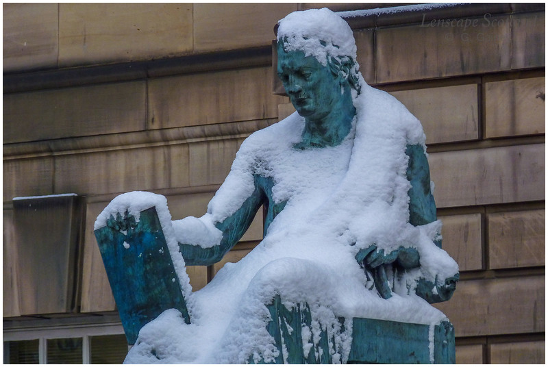David Hume statue in snowy garb