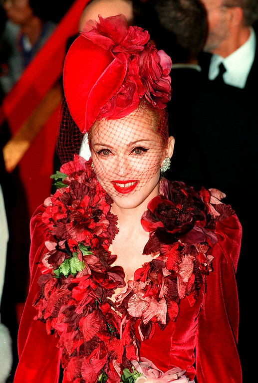 ". In this Dec. 14, 1996 file photo, ""Evita\"" star Madonna arrives at the film\'s premiere at the Shrine Auditorium in Los Angeles. Madonna reluctantly testified against Robert Dewey Hoskins, who was convicted in 1996 of threatening to kill the singer-actress. Hoskins served a 10 year prison sentence but escaped from a Los Angeles mental hospital in 2012 and was arrested after several days of searching by police. At trial, Madonna told a jury she felt sick to her stomach being in the same room with Hoskins, who was shot by one of her bodyguards at her Los Angeles home while she was in Florida. \""I couldn\'t believe it was actually happening and he had tried to make his threats a reality,\"" Madonna testified during Hoskins\' trial.  (AP Photo/Mark J. Terrill, file)"