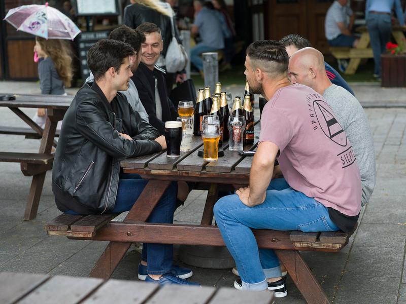 Group of friends enjoying beer at pub, Limerick, Republic of Ireland