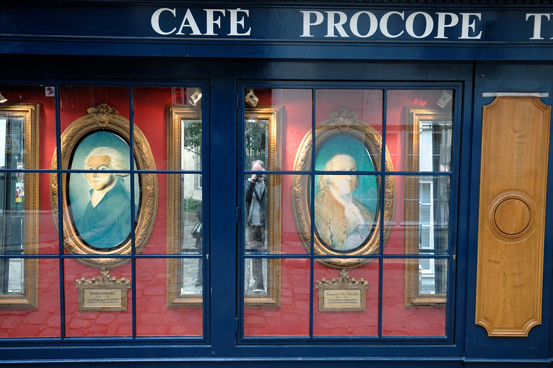 Cafe Procope advertises two of its illustrious patrons, Robespierre and Benjamin Franklin.