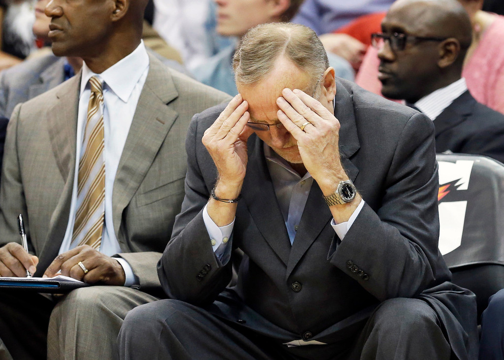 . Minnesota Timberwolves head coach Rick Adelman holds his head in the second half of an NBA basketball game against the Denver Nuggets, Wednesday, Nov. 27, 2013, in Minneapolis. The Nuggets won 117-110. AP Photo/Jim Mone)